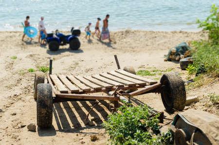 Boat trailer on the sea sandy beach.