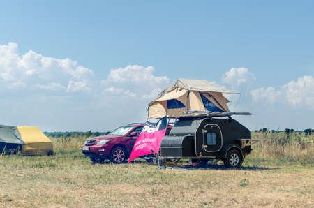 Sanzhejka, Ukraine, August 05 2018: compact camper caravan with a rooftop tent