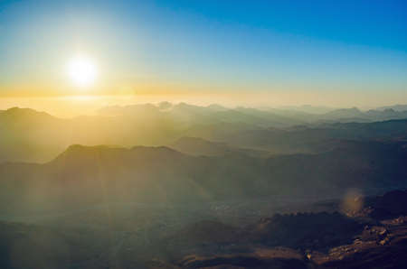 View from the mountain of Moses, a beautiful sunrise in the mountains of Egypt. Banco de Imagens