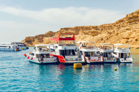 Sharm El Sheikh, Egypt May 08, 2019: Tourist pleasure boats in the harbor of Sharm El Sheikh