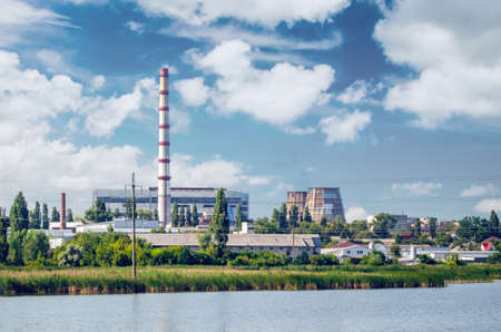 Thermal power plant with chimneys, industrial landscape.