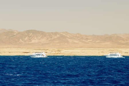 White pleasure boat on the background of the nature reserve of the Ras Muhammad. Stok Fotoğraf