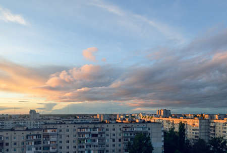 Beautiful clouds during sunset over the city, cityscape.