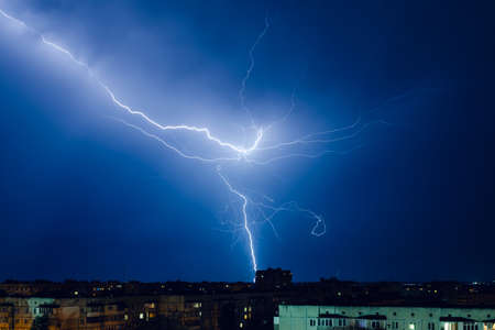 Thunderstorm with lightning and thunder over the night city.
