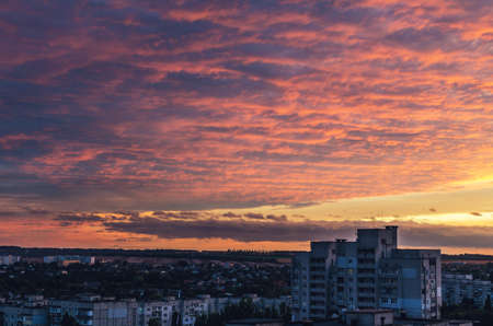 Beautiful red fiery sunset over the city, cityscape. Stok Fotoğraf
