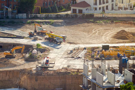 Aerial view of construction site, construction of new building in residential area.