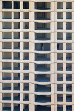 Facade of a multi-storey building under construction.