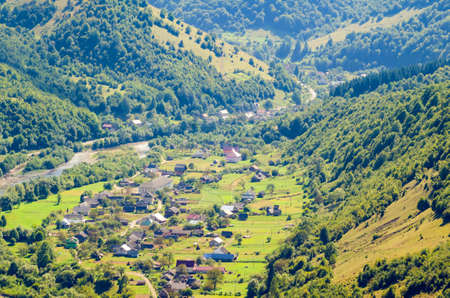 Ukraine Carpathians, a settlement in a valley of mountains, beautiful landscape aerial view.