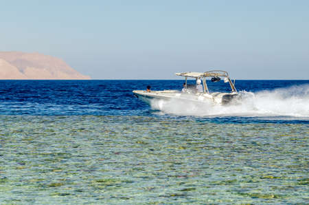 Speed boat rushing through the clear waters of the Red Sea. Stok Fotoğraf