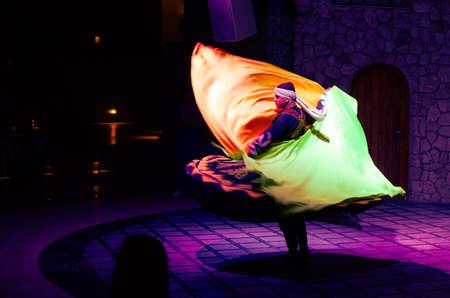 Sharm El Sheikh, Egypt, May 11, 2019: Egyptian man performing tanoura folk dance or sufi whirling Editöryel