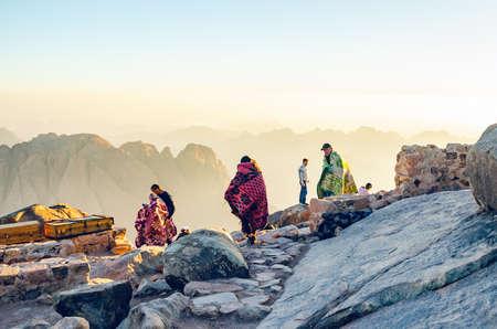 Sinai Peninsula, Egypt, May 9, 2019: Pilgrims meet the dawn on the Moses Mountain, Sinai Peninsula, Egypt
