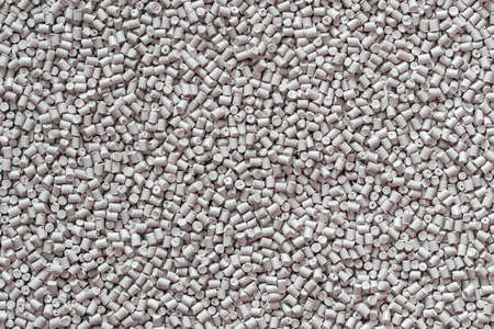 Gray polymer dye in granules, background texture.