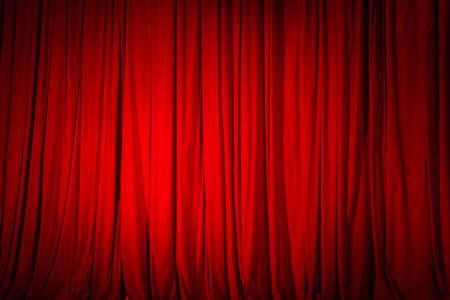 Closed red curtain in the theater, background texture. 免版税图像