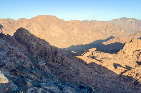 Mountain landscape at sunrise, view from Mount Moses, Sinai Peninsula, Egypt. Archivio Fotografico