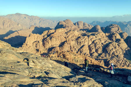 Pilgrims descend from Mount Moses at sunrise.