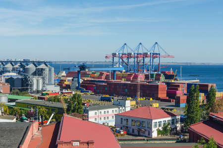 Port cargo crane loads a container onto a cargo ship.