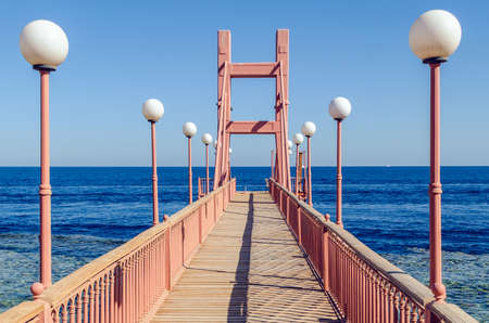 Empty pier with sea view on a sunny day.
