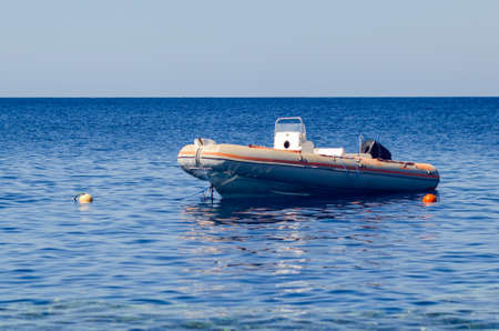 Rescue inflatable boat in the blue sea.