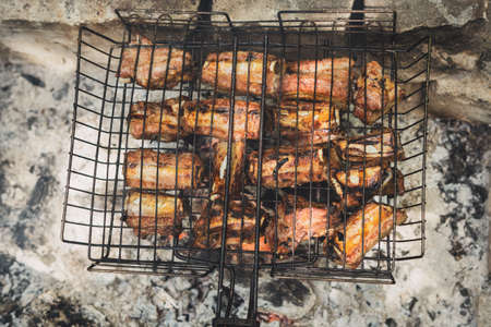 Delicious, juicy ribs are cooked over charcoal.