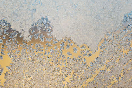 Abstract frosty pattern on glass, background texture.