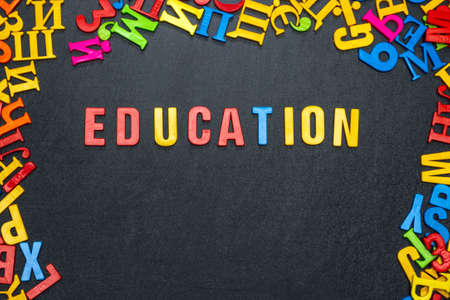 Education, word made from bright color letters on black background.