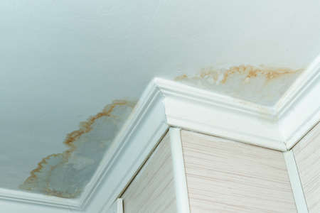 Neighbors have a water leak, water-damaged ceiling, close-up of a stain on the ceiling. Reklamní fotografie