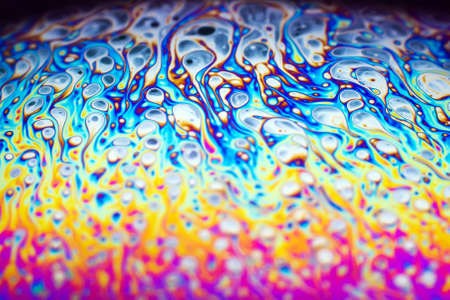 Beautiful psychedelic abstraction formed by light on the surface of a soap bubble. Stock Photo