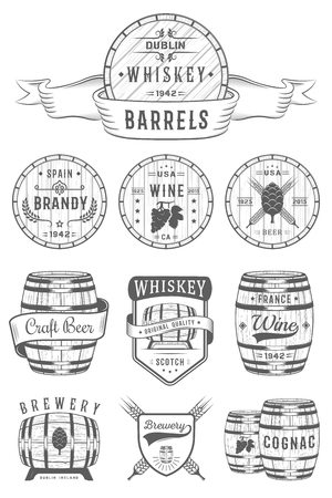 Set of wooden casks with alcohol drinks emblems and labels.