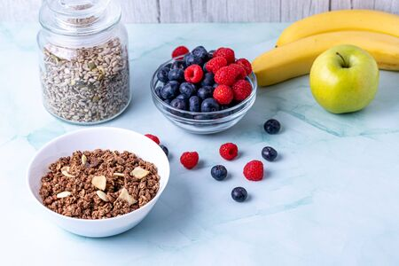 Muesli with berries on the wooden table Stok Fotoğraf - 147626555