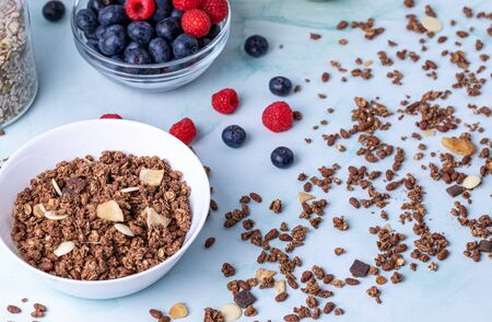 Muesli with berries on the table Stok Fotoğraf - 147581339
