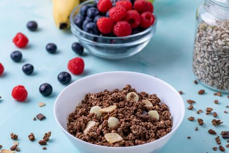 Muesli with berries on the table Stok Fotoğraf - 147581598