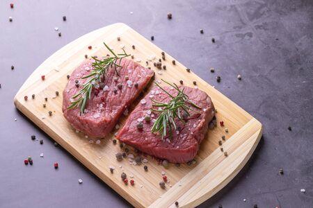 fresh raw sliced beef meat steak on a wooden board Stok Fotoğraf - 148672389