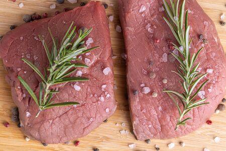 fresh raw sliced beef meat steak on a wooden board Stok Fotoğraf - 148672390