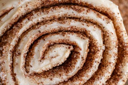 Raw homemade cinnamon buns ready to be baked