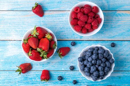 Berries, summer fruits on a wooden table. Healthy lifestyle concept. Stok Fotoğraf - 148672392