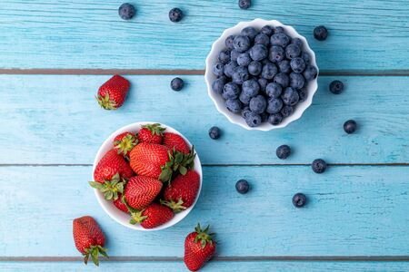 Berries, summer fruits on a wooden table. Healthy lifestyle concept. Stok Fotoğraf - 148672395