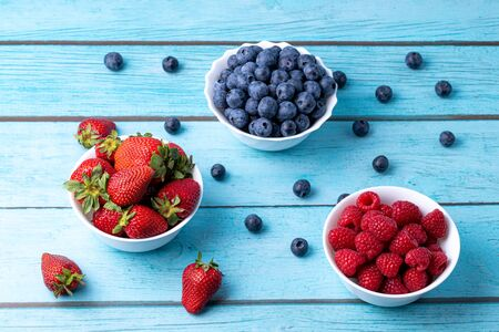 Berries, summer fruits on a wooden table. Healthy lifestyle concept. Stok Fotoğraf - 148672397