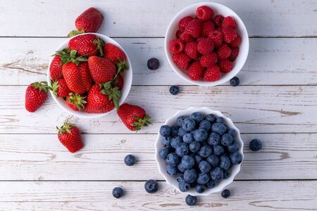 Berries, summer fruits on a wooden table. Healthy lifestyle concept. Stok Fotoğraf - 148672399