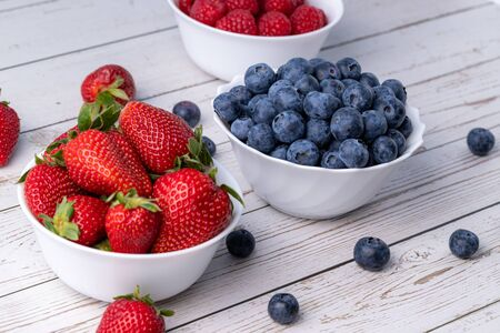 Berries, summer fruits on a wooden table. Healthy lifestyle concept. Stok Fotoğraf - 148672400