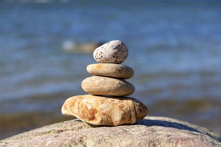 Concept of harmony and balance. Rock zen on a background of a summer beach. Stok Fotoğraf - 148672468