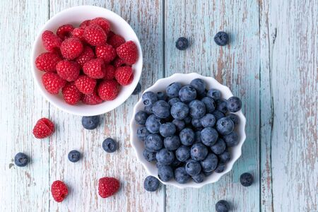 Berries, summer fruits on a wooden table. Healthy lifestyle concept. Stok Fotoğraf - 148672470