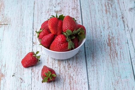 Berries, summer fruits on a wooden table. Healthy lifestyle concept Stok Fotoğraf