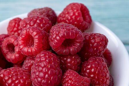 Raspberries close-up. Macro image of fresh raspberries