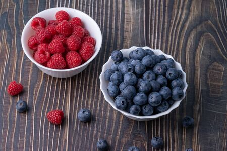 Berries, summer fruits on a wooden table. Healthy lifestyle concept. Selective focus