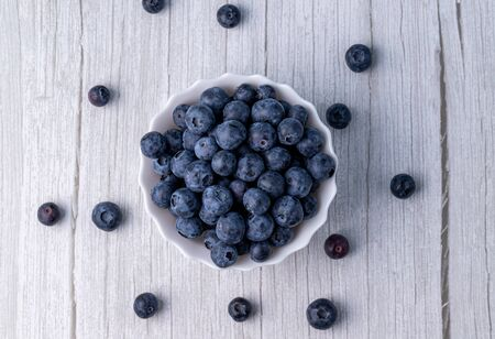 Berries, summer fruits on a wooden table. Healthy lifestyle concept. Stok Fotoğraf