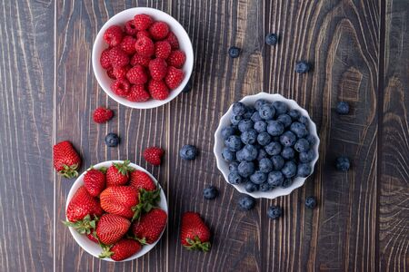 Berries, summer fruits on a wooden table. Healthy lifestyle concept. Stok Fotoğraf - 150106977