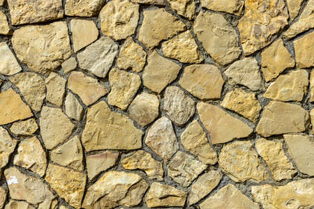Old stone wall background texture close up. Stone background.