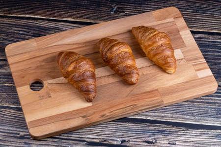 Croissants on a wooden board. Stok Fotoğraf