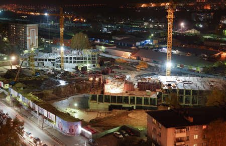 site: Night construction site with cranes, special equipment, lighting
