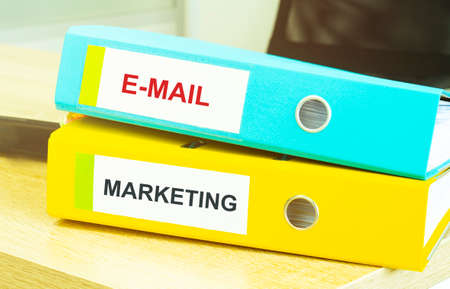 Two office folders with text E MAIL MARKETING